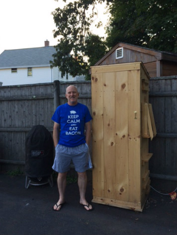 Paul Kuconis and his home-built smokehouse