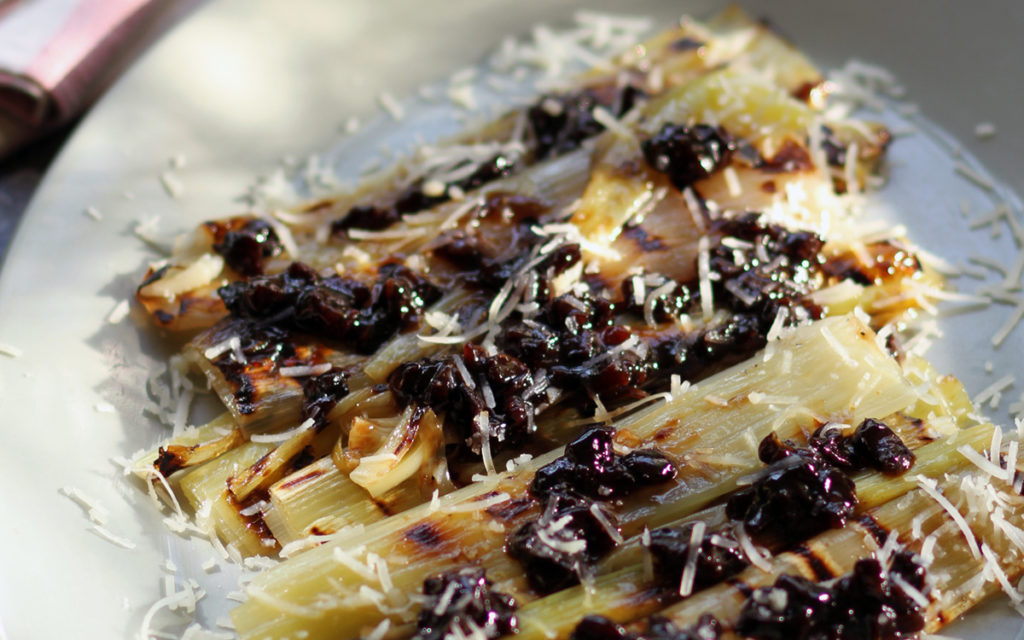 Grilled Leeks with Shaved Sheep's Milk Cheese and Prunes
