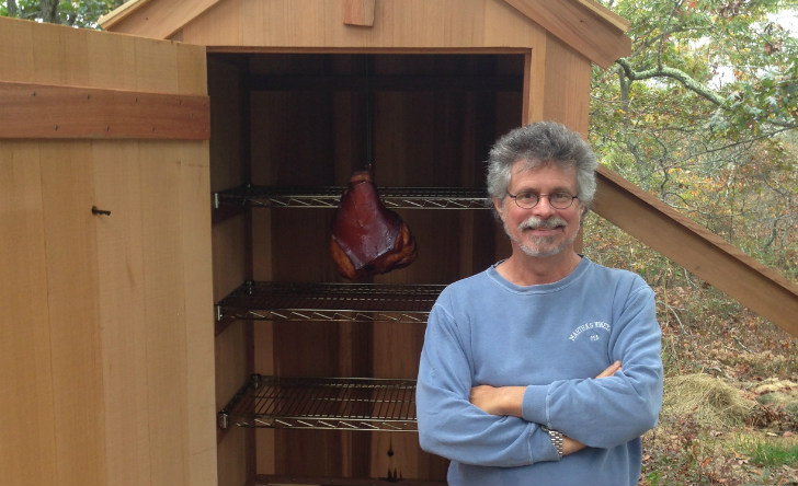 Steven Raichlen in front of smokehouse