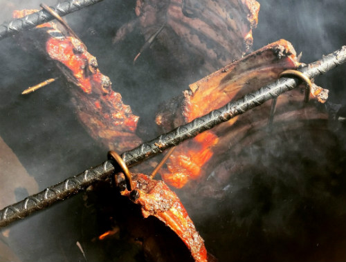 Ribs hanging in Pit Barrel Cooker