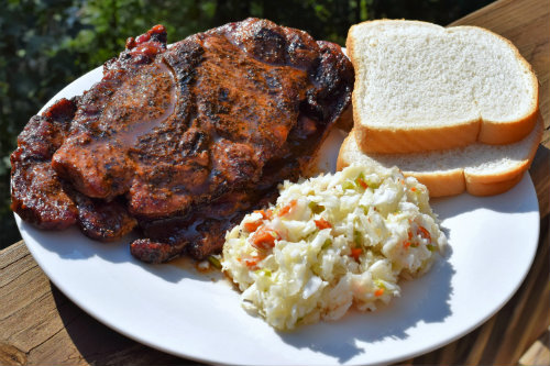 Pork steaks with slaw and white bread