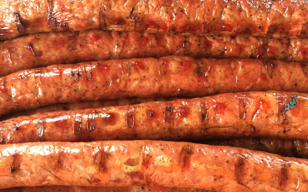Close up of rope sausage with grill marks