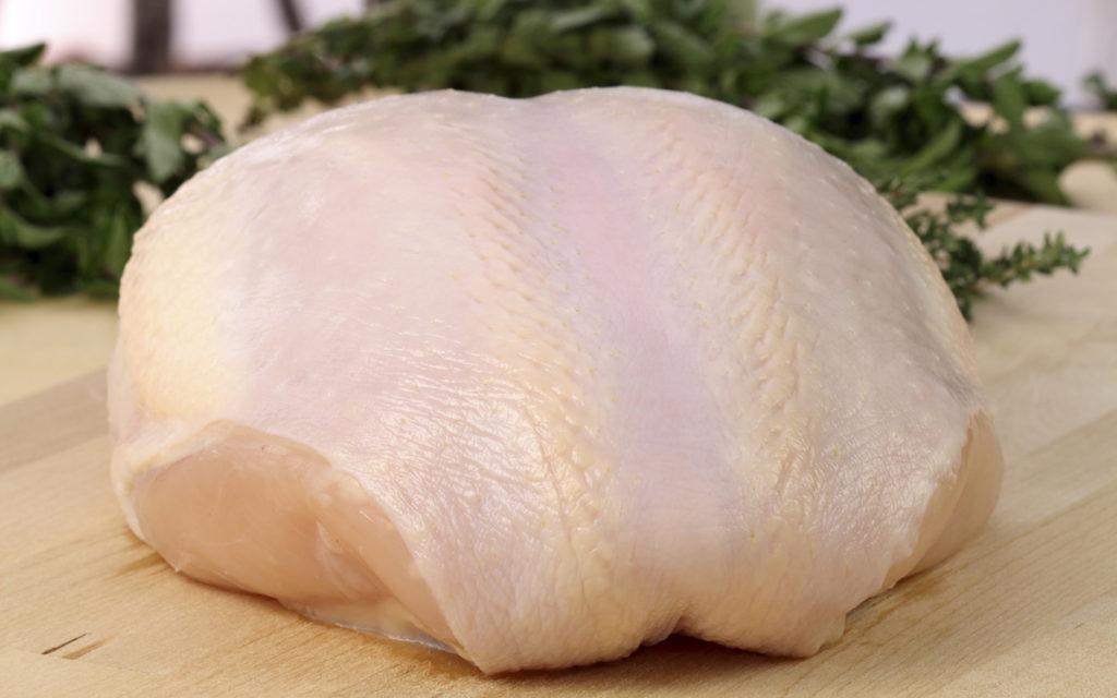 Raw whole turkey breast